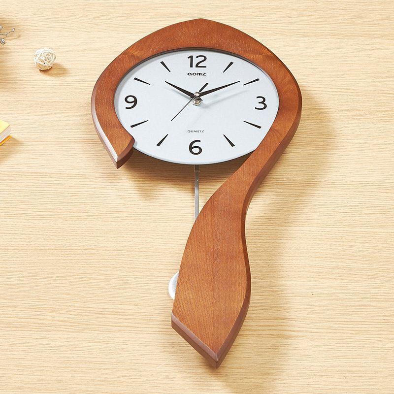 Horloge murale silencieuse en bois simple moderne cr atif for Horloge murale bois moderne