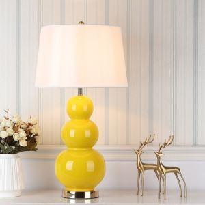 Lampe à poser en céramique jaune brillant style simple